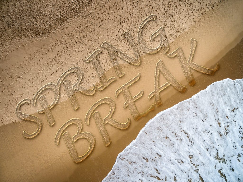 SPring break written on the beach